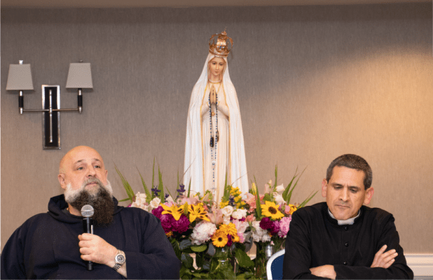 Fr. Isaac and Fr. Rodriguez speaking at an Ask Father session with Our Lady of Fatima statue behing them
