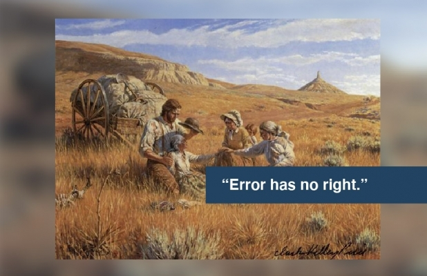 "Family in a field with quote ""Error has no right"""