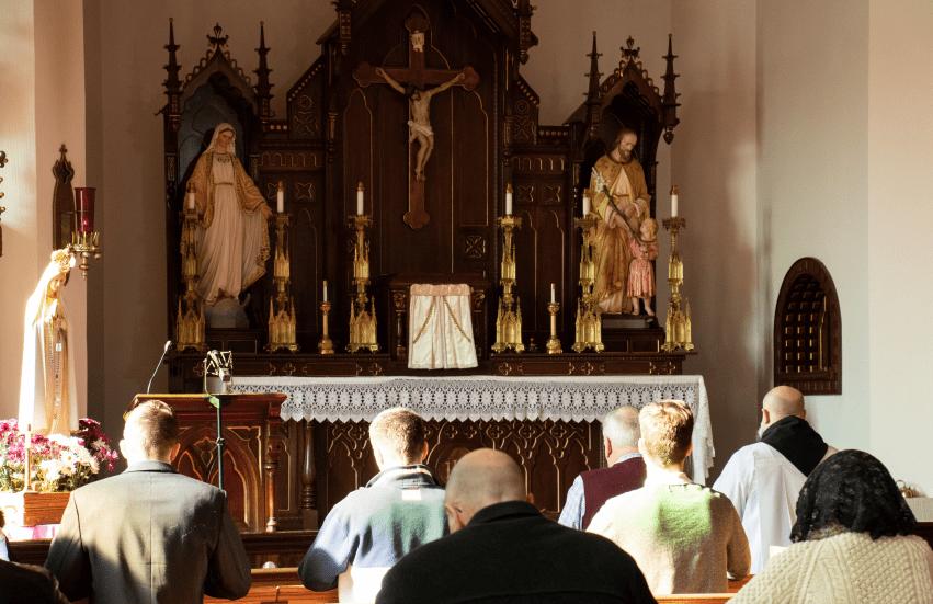 Faithful praying inside of church
