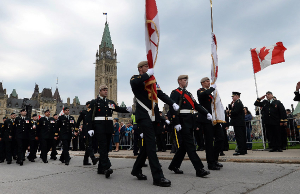 Soldiers parade from Parliament Hill as they take part in the National Day of Honour in Ottawa on Friday, May 9, 2014. The commemoration honoured the soldiers who participated in the war in Afghanistan and included many of the family members of the 158 soldiers who died in the 12-year conflict. THE CANADIAN PRESS/Sean Kilpatrick
